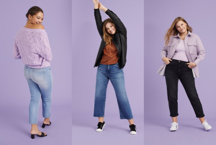 Woman poses with back to camera wearing a lilac jumper and blue light wash jeans, woman poses with legs apart and hands raised in the air wearing burnt orange top, black jacket, mid-wash blue jeans and black pumps, woman poses with legs apart and hands in pockets wearing lilac top, lilac shacket, black jeans and white pumps.