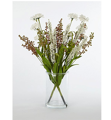 A bouquet of white flowers in a clear vase
