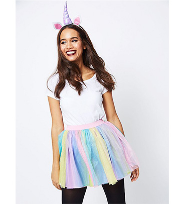 Woman wearing George Halloween unicorn costume