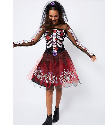 Woman wearing George Day of the Dead Halloween costume