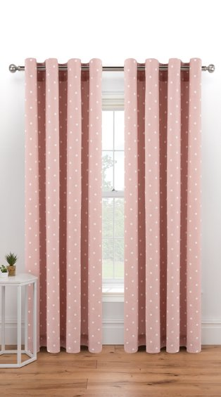 Large white window features pink spotty eyelet curtains hanging from silver-tone curtain rail.