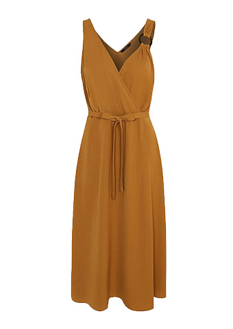 Channel festival style in a mustard-coloured dress