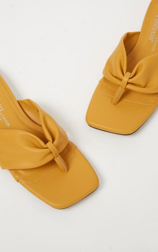 Ochre ruched toe post sandals.