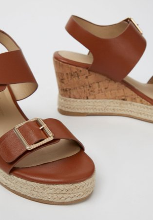 Tan wedge heel sandals.