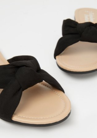 Black knotted sandals.