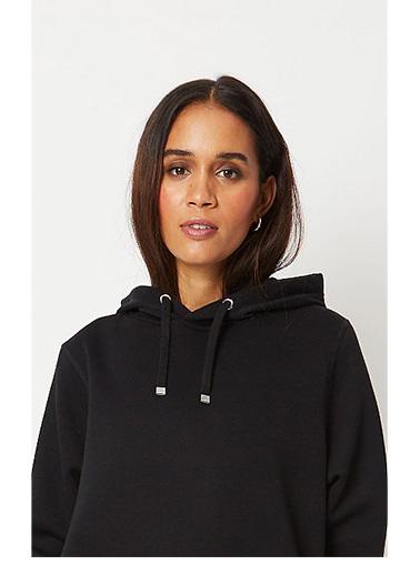 Woman wearing black hoodie