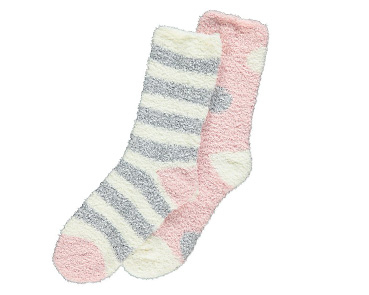 Product image of grey and white striped socks and pink socks with grey and white spots