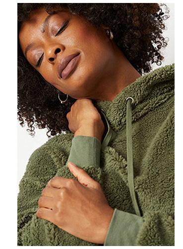 Woman wearing khaki borg hoodie