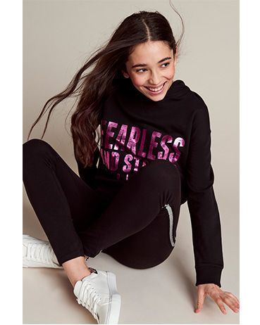 This black hoodie comes designed with a metallic slogan saying 'Fearless and strong #Girlpower'