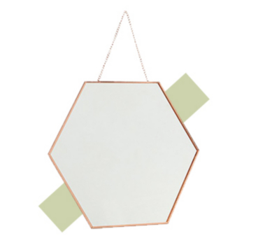 Create the illusion of space and light with a hanging wall mirror