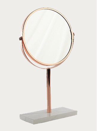 Rose gold swivel mirror on grey stand