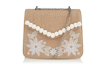 Featuring a silver-tone chain strap, this bag is designed with pom poms and floral patterns