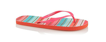 These versatile pink striped flip flops have a textured foam base and simple thong strap