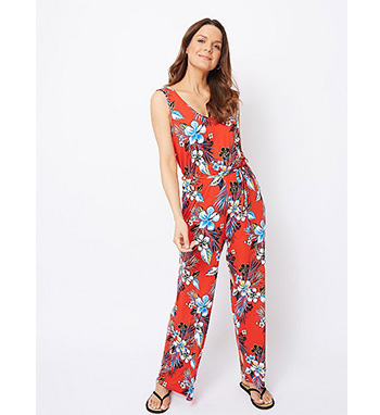 This gorgeous red jumpsuit features an all-over floral print and V-neck