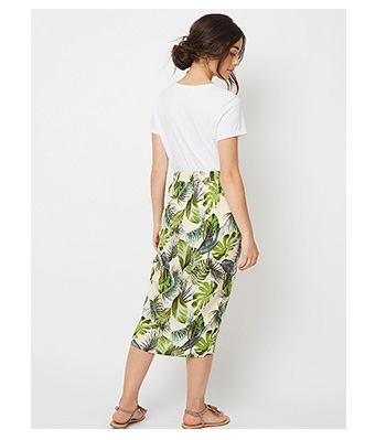 Team this white T-shirt with a green tropical print midi skirt for the perfect wedding guest ensemble