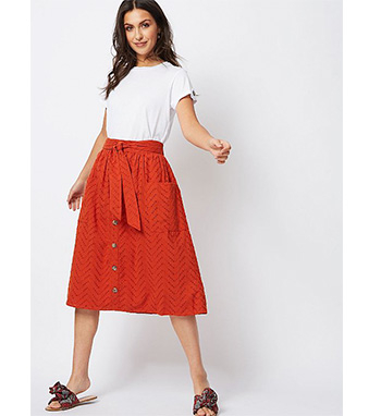 Brighten up any white T-shirt with a bold orange midi skirt