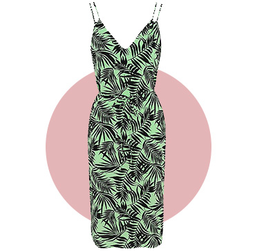 This summer-ready green slip dress has a palm print and V-neck