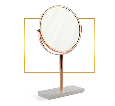 This fantastic copper mirror comes with a slim stand and swivel function