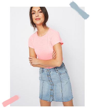Match a soft pink top with a denim skirt