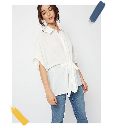 Pair jeans with a white batwing shirt