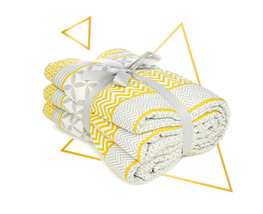 Snuggle up in style with this yellow geometric print quilted throw