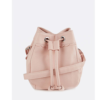 This contemporary update on the classic bucket bag is this season's answer to crossbody couture