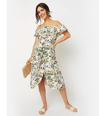 Designed with all-over florals, this dress features a Bardot neckline and front split