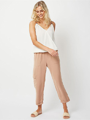Team a white vest with beige cropped trousers for a smart-casual look