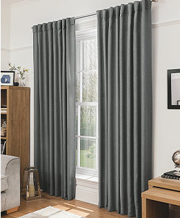 Made from textured fabric, these charcoal curtains will create a warm, private environment