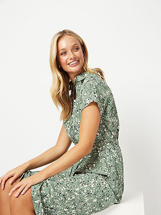 This green patterned midi dress is the perfect layer for the new season