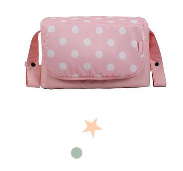 This pink polka dot changing bag is perfect for carrying baby essentials