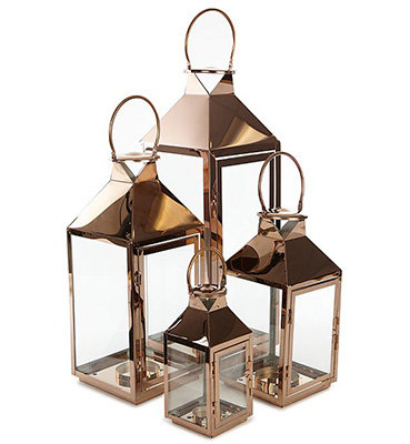 Four lanterns with copper and glass casing
