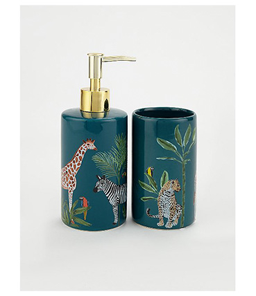 Green dispenser with gold-tone pump and tumbler, both designed with a giraffe, zebra and parrot among leaves