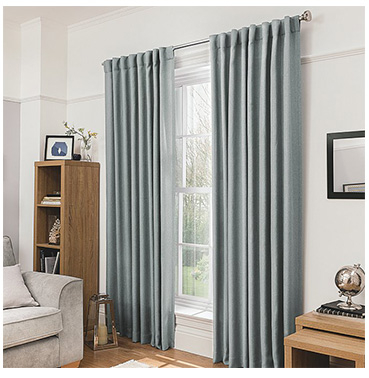 Light grey tab top curtains in a living room setting