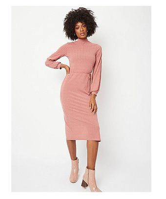 Woman wearing a pink ribbed bodycon midi dress and pink heeled boots