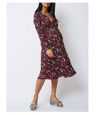 Image of pregnant woman wearing a burgundy floral dress