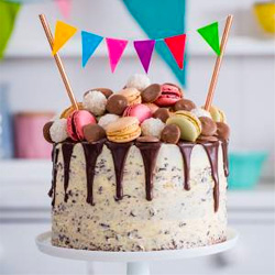 Cake covered in macaroons on a stand