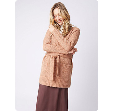 Woman wearing caramel brown longline belted bouclé cardigan and brown skirt