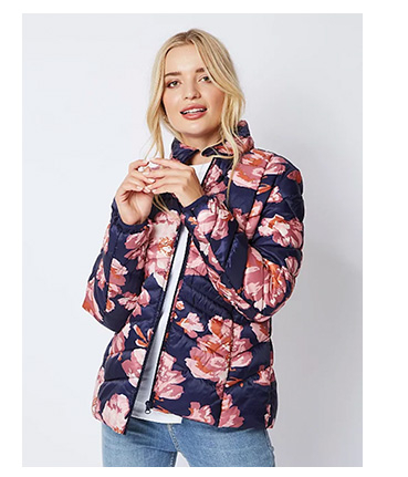 Woman wearing navy floral pac a mac