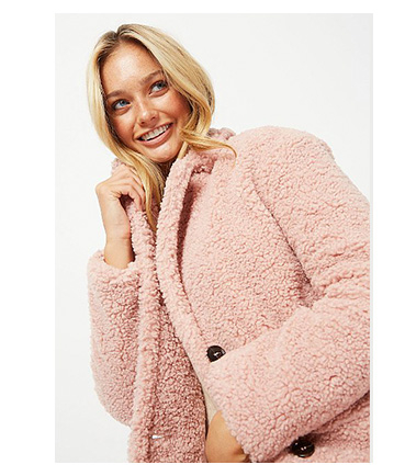 Woman wearing pink teddy coat