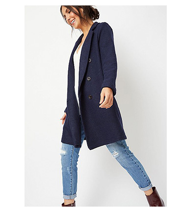 Woman wearing navy double breasted longline jacket