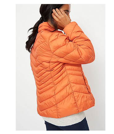 Woman wearing orange packable padded coat