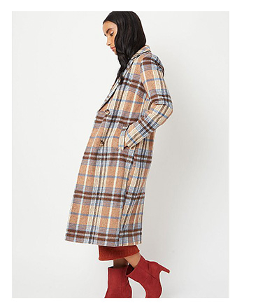 Woman wearing beige check longline double breasted formal coat