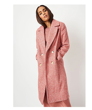 Woman wearing pink herringbone double breasted oversized coat