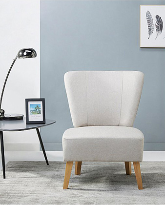 Cream chair with side table and chrome-effect table lamp