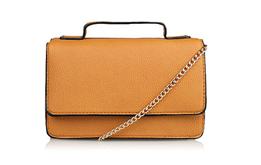 This leatherette bag is the compact companion you've been looking for