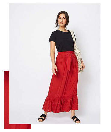 This red maxi skirt is created in a lightweight cheesecloth fabric and features a Broderie Anglaise trim
