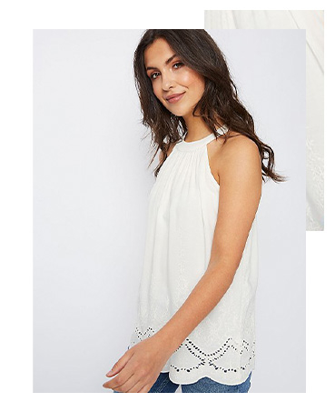 This strappy cami has a flattering high neckline and pretty cut-out detailing along the hem