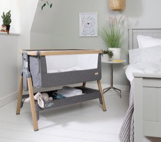 Bedroom features double bed with side table topped with artificial plant and oak and charcoal Tutti Bambini Cozee crib.