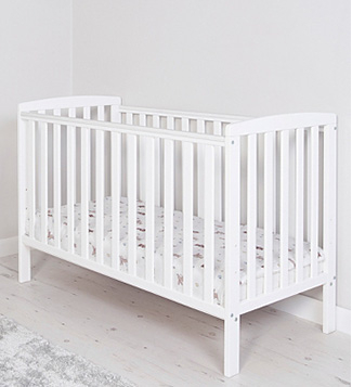 White cot in a room